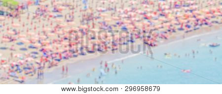Defocused Background With A Crowded Beach In  Italy. Intentionally Blurred Post Production For Bokeh