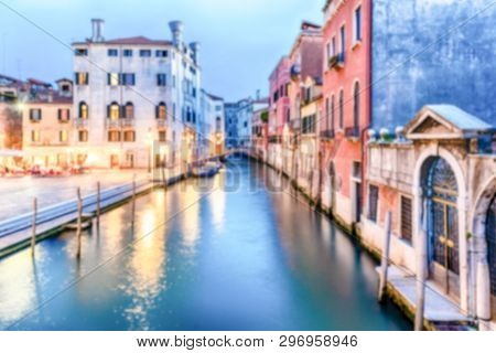Defocused Background Of Picturesque Canal With Beautiful Reflections In Castello District Of Venice,