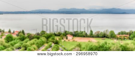 Defocused Background With Aerial View Of Lake Garda, Italy. Intentionally Blurred Post Production Fo
