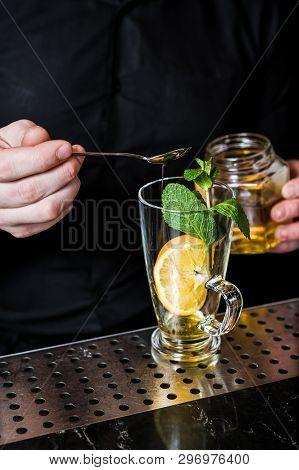 Bartender Prepares Fruit Tea With Cranberries In A Glass, Dark Background