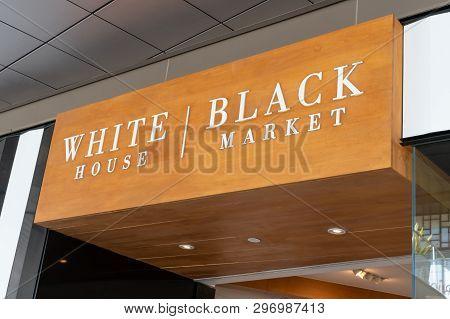 White House Black Marked Retail Store Exterior And Trademark Logo