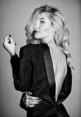 Feeling so sexy in masculine clothes. Tempting horny sexy woman enjoy wearing oversize jacket. Fashion concept. His jacket suits me. Girl playful sexy blonde wearing male jacket on naked body poster