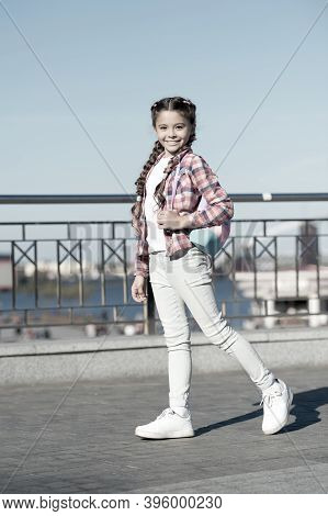 The Street Style Way. Little Cute Child With Beautiful Long Braided Hair Style. Adorable Small Girl