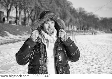 Travel And Vacation Concept. Winter Outfit. Guy Jacket Hood. Man Warm Jacket Snowy Nature Background