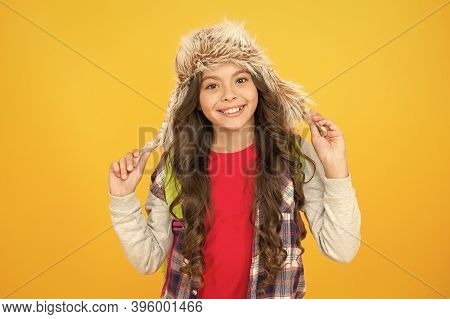 Eskimo Style. Soft Furry Accessory. Child Schoolgirl Long Hair Soft Hat Enjoy Softness. Winter Seaso