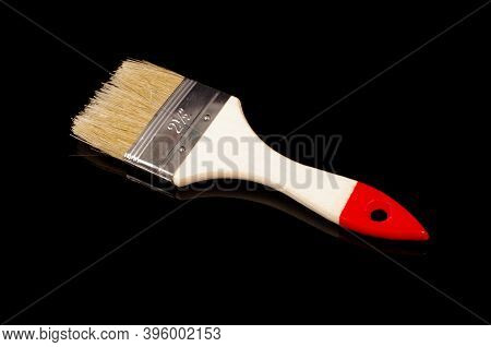 Paintbrush For Construction And Redecoration Isolated On Black Reflective Background