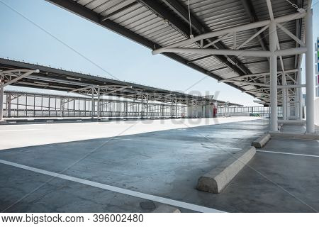 Car Parking Lot Area On Deck Floor Of Shopping Mall, Perspective View Empty Of Car Park Structure Bu