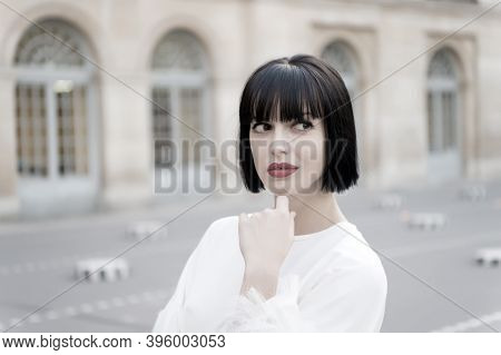 Mysterious Female Has Idea. Girl Fashionable Lady With Bob Hairstyle Outdoor Urban Architecture Back