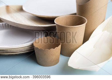 Biodegradable Disposable Dishes On Light Blue Background. Recycling Concept