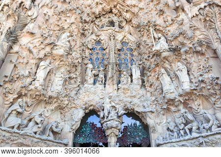Barcelona, Spain - April 02, 2015: Main Entrance Facade Of Cathedral La Sagrada Familia. Catalan Arc