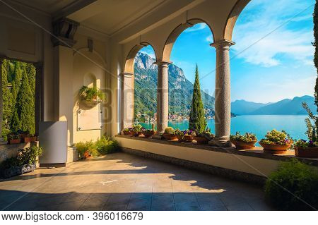 Stunning Balcony Decorated With Flowers And Ornamental Objects. Amazing View From The Cozy Balcony W