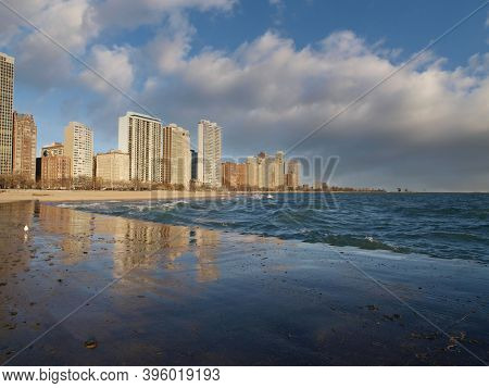 Chicago Illinois lakefront skyline view with cloudy sky.
