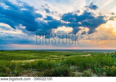 Scenic Sunset With Clouds In Sky In Steppe.