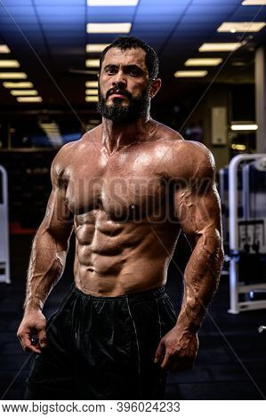 Strong Man With Perfect Sport Healthy Body Physique In Dark Fitness Club Gym