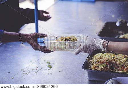 The Hands Of The Poor Receive Food From The Hands Of The Humane : The Concept Of Feeding