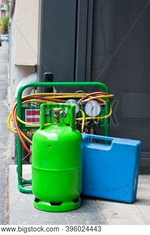 Green Butane Gas Cylinder And Blue Tool Case