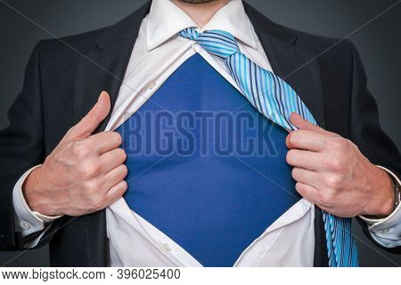 Strong Businessman As Superhero Is Opening His Shirt.