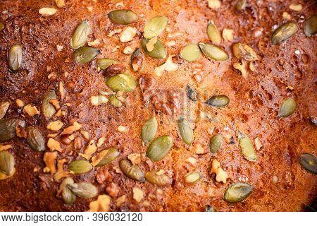 Pumpkin Pie With Lemon Zest, Pumpkin Seeds, Cinnamon, Fragrant And On A Dark Background. Healthyfood