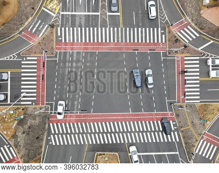 The Movement Of Cars At Crossroads In City, Aerial View.