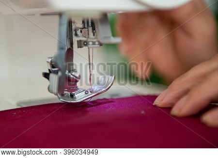 Close-up Image Of Tailor Sewing On A Sewing Machine