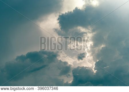Gray Sky And Fluffy Clouds With Sunlight. Cloudy Sky. Background For Death And Sad Concept. Sad And