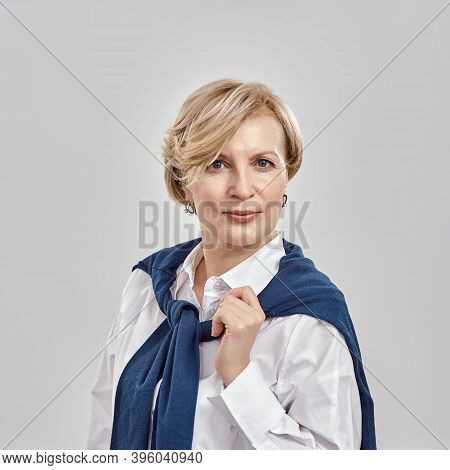 Close Up Portrait Of Elegant Middle Aged Caucasian Woman Wearing Business Attire Looking At Camera W