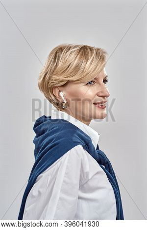 Portrait Of Elegant Middle Aged Caucasian Woman Wearing Business Attire, Smiling Aside While Using H