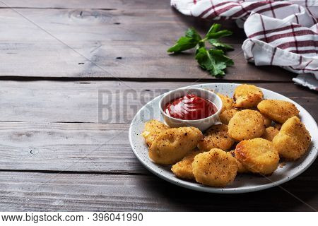 Fried Chicken Nuggets With Tomato Ketchup Sauce. Wooden Background. Copy Space.