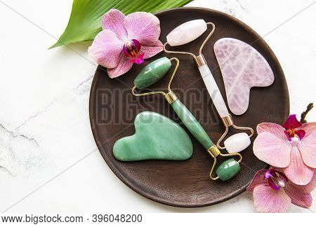 Jade Face Rollers For Beauty Facial Massage Therapy. Flat Lay On White Marble  Background