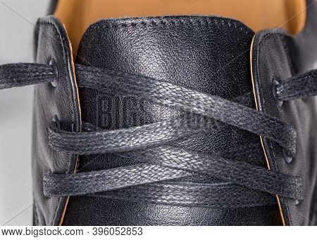Untied Shoe Lacing Traditional Criss Cross Method With Flat Shoelace, Fragment Of The Men's Black Le
