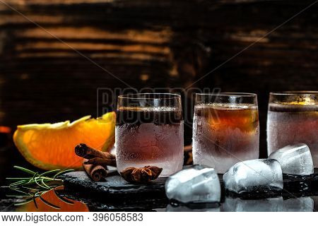 Alcoholic Drink And Orange In Ice Glasses. Alcoholic Booze Cocktail. Erman Digestif Made With 56 Her