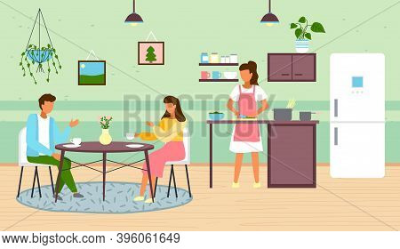 Woman Cooking At Kitchen. Female Preparing Food At Home. Young People Drinking Coffee Or Tea Sitting