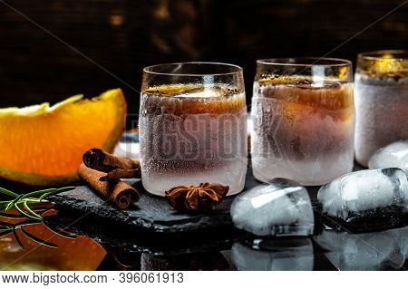 Alcoholic Drink And Orange In Ice Glasses. Alcoholic Booze Cocktail. German Digestif Made With 56 He