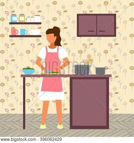 Woman Cooking At Kitchen. Female Cutting Salad At Wooden Board With Knife. Bowl With Salad, Pan With