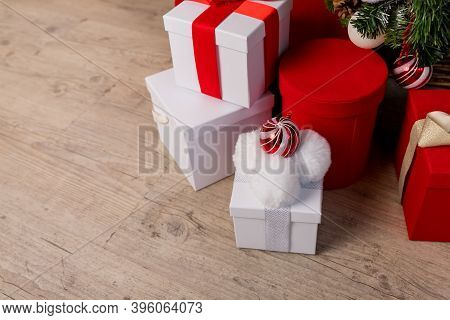 Christmas Gift Boxes And Shopping Package Under Chrismas Tree.new Year Present Paper Package. Gift P