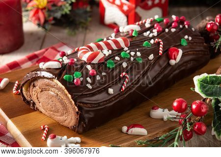 Chocolate Yule Log Christmas Cake On Wooden Table
