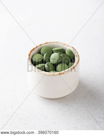 Chlorella Pills On A White Background, Concept Of Superfood And Detox