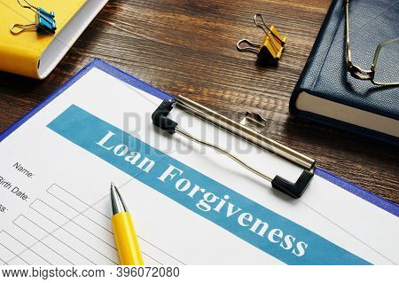 Form Of Loan Forgiveness Agreement And Yellow Pen.