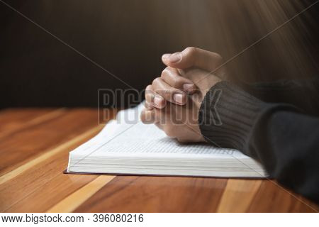 Woman Hands Praying To God With The Bible. Woman Pray For God Blessing. Religious Beliefs Christian