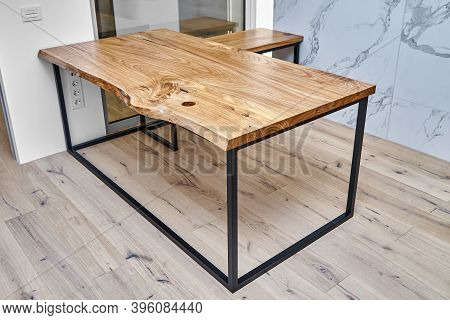 Live Edge Elm Desk With Metal Base In A Modern Home Office