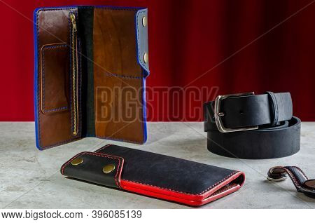 Mens Wallet Longer Made Of Genuine Black Leather Handmade With A Red And Blue End On A Red Backgroun