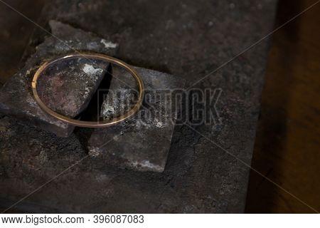 Close-up of bangle on a metallic piece