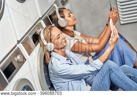 Two students in laundry room