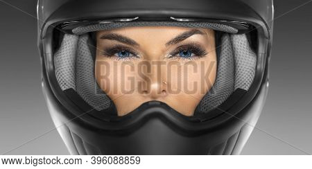 Close-up Portrait Of A Sexy Woman In A Motorcycle Helmet Looking At Camera.