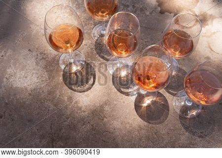 Pink Wine In Glasses With Shadows, Top View With Shadows Overlay, Wine Testing Concept