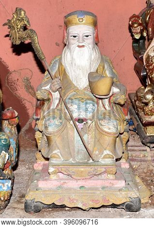 Traditional God Statue On A Shrine At A Chinese Temple
