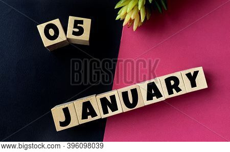 January 5 On Wooden Cubes On A Black And Pink Background.beginning Of Year .calendar For January.