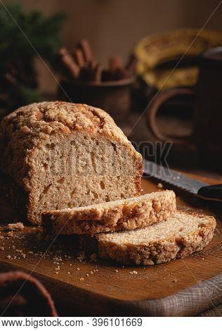 Loaf Of Banana Nut Bread Sliced On A Rustic Cutting Board