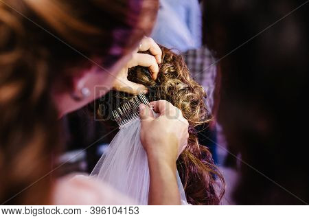Mother Hands Holding Ornaments And Helping Dressing Veil Bride. Bridesmaid Preparing Bride, Helping