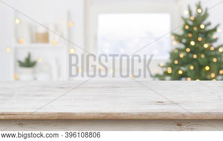 Table Space In Front Of Defocused Window Sill With Christmas Tree